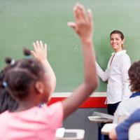 Image of teacher in classroom