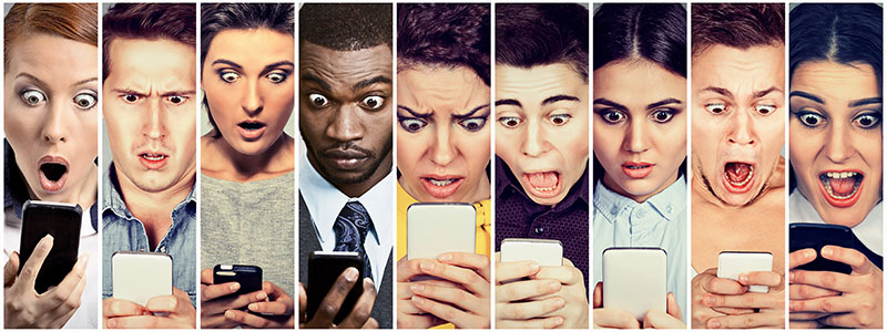 Several diverse faces look into cell phones with expressions of shock and surprise