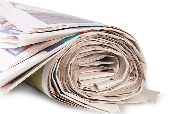 Image of a newspaper rolled up