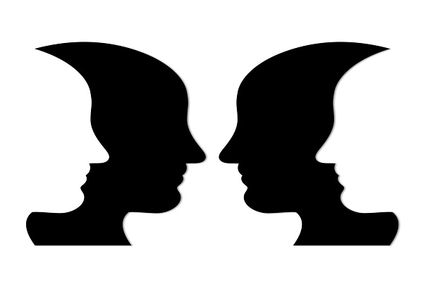 Illustration of two black face silhouettes overlapped by two white face silhouettes