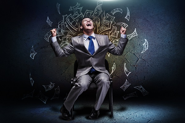 Image of businessman sitting down rejoicing with illustrations of money flying in the air