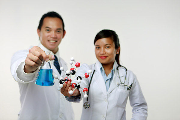 Image of a male and female scientist presenting a beaker and molecular structure