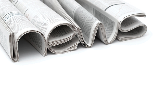 Image of newspapers shaped to spell the word News