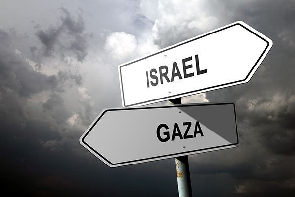 Image of road signs pointing to Israel and Gaza