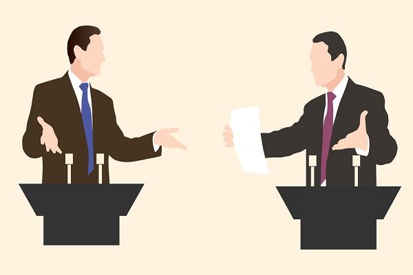Image of two businessmen at podiums debating