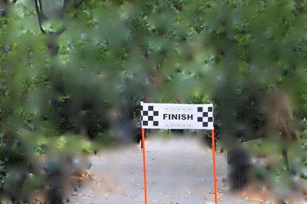 image of a finish line sign in a park with surrounding area blurred