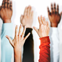 Image of hands raised in air