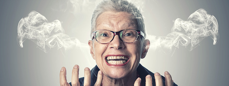 Angry Older woman with smoke coming out of her ears