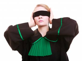 Image of woman holding blindfold over her eyes