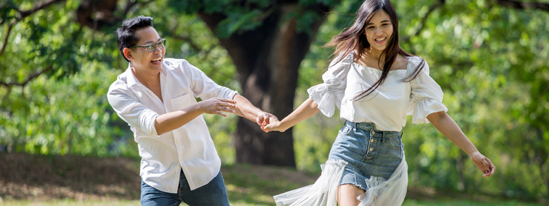 asian couple in love running in park having happiness and joy