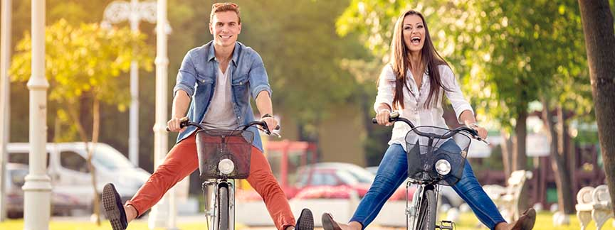Silly couple riding bikes in a funny way