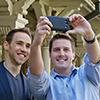 Two men taking a selfie photo