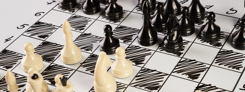 Image of black and white chess pieces on a chessboard