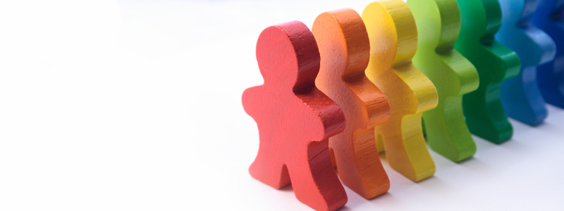 Image of multicolored wooden children's toys resembling people