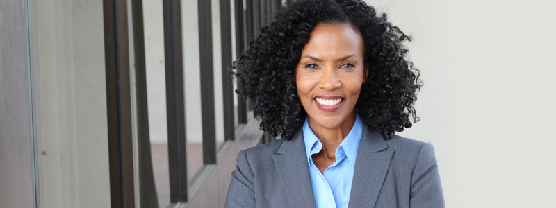 Image of a confident African American woman in business attire