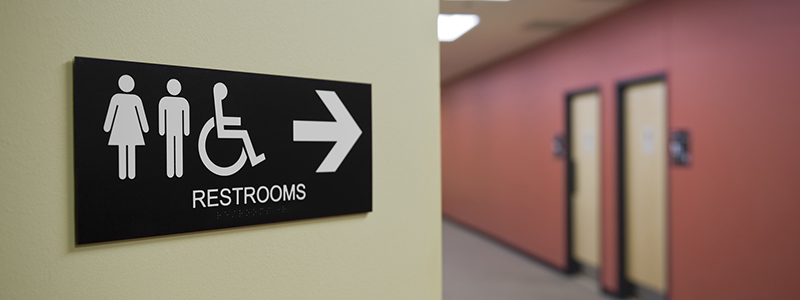 Image of bathroom sign with male, female, handicapped icons