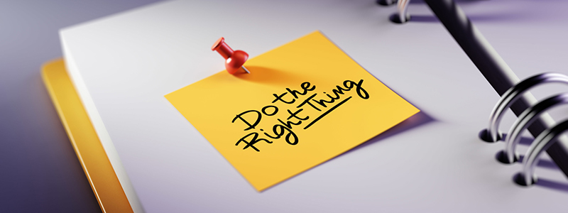 "Image of a yellow post-it note on a blank notebook page that reads ""Do the right thing"""