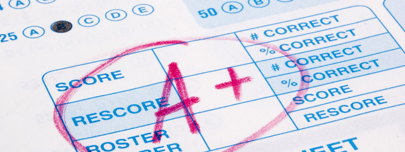 "Image of test scantron sheet filled out and marked up with red text ""A+"" on it"