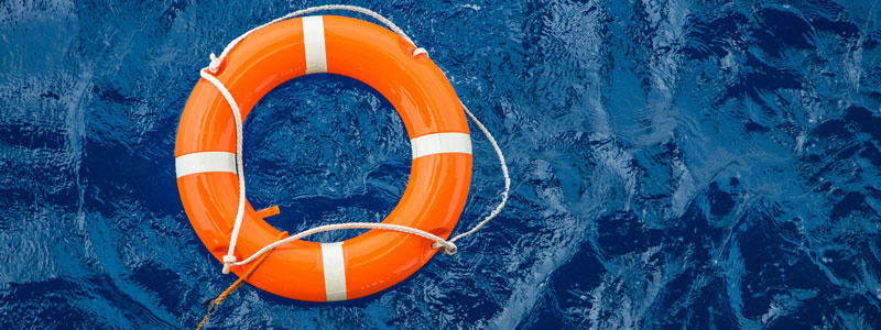 Image of life preserver floating on water