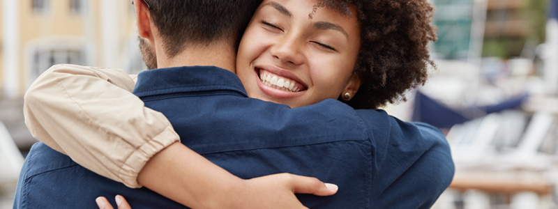 Image of an interracial couple embracing in a hug