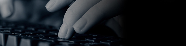 Spooky image of hands typing on a keyboard