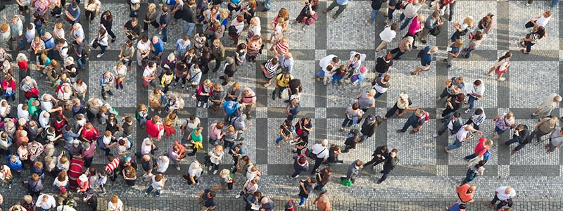 Image of people walking down a street from overhead