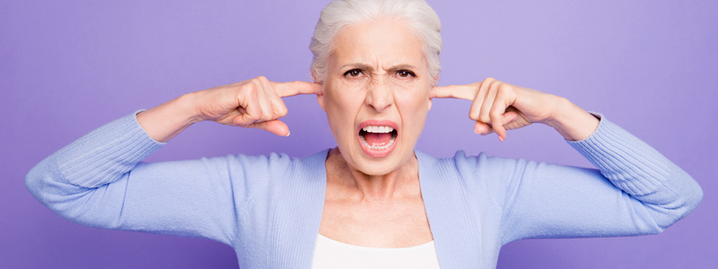 Image of woman screaming with her fingers in her ears