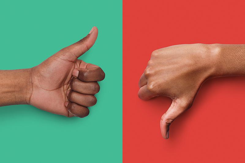 Image of thumbs up and thumbs down over red and green backgrounds