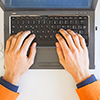 image of man typing on laptop